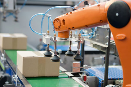 Robotic arm working on a production line